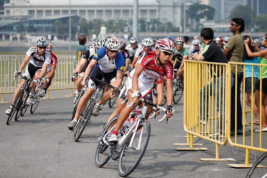Cyclists at the OCBC Cycle event in 2014. This year, a total of 400 subscribers of The Straits Times All-in-One package will enjoy priority registration for The Straits Times Ride (about 23km) from March 4. -- PHOTO: OCBC BANK