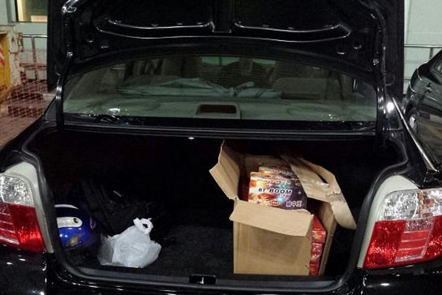 The boot of the Malaysian-registered car, which contained 60 firecrackers of two different types. -- PHOTO: ICA