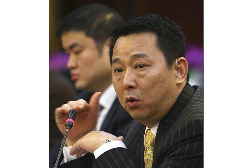 Liu Han, former chairman of Hanlong Mining, speaks during a conference in Mianyang, Sichuan province, in this March 21, 2008 file photo. The former mining tycoon, who is connected to the eldest son of retired domestic security chief Zhou Yongkan