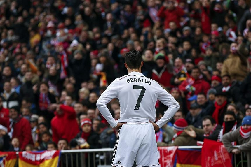 Real Madrid's Cristiano Ronaldo reacts during their Spanish first division soccer match against Atletico Madrid at the Vicente Calderon stadium in Madrid, on Feb 7, 2015. The football star drew criticism in the changing room by partying for his 30th
