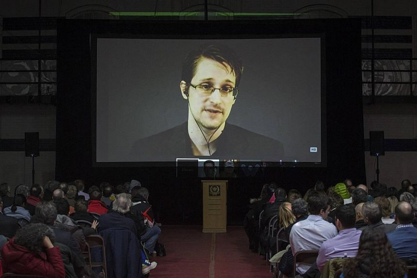 Former US National Security Agency contractor Edward Snowden appearing live via video during a student-organized world affairs conference at the Upper Canada College private high school in Toronto, on Feb 2, 2015. -- PHOTO: REUTERS