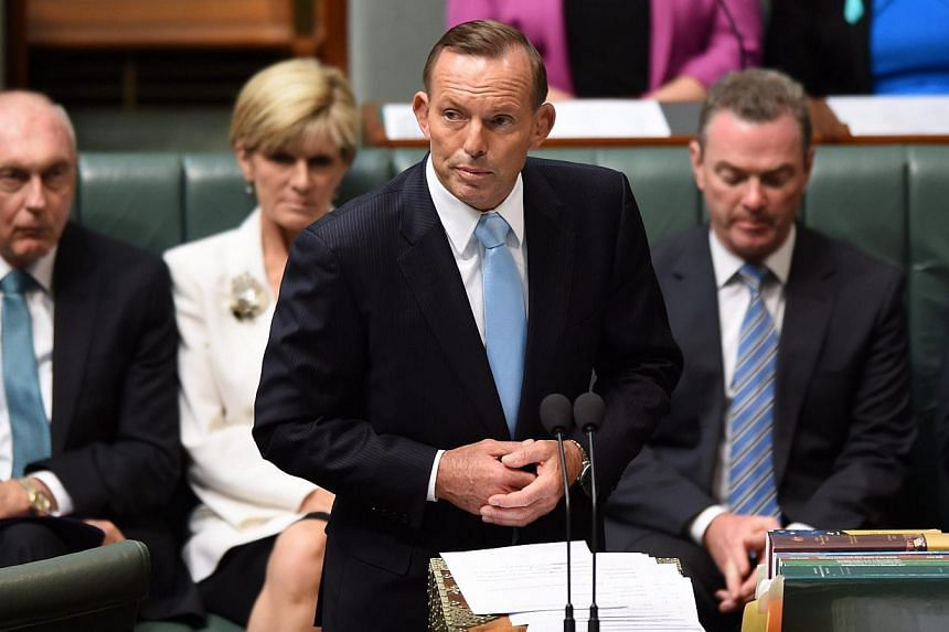 Australian Prime Minister Tony Abbott speaks during a condolence motion for the Sydney siege survivors at Parliament House in Canberra, Australia on Feb 9, 2015. The lone gunman which killed two hostages during the siege was inspired by the Islamic S