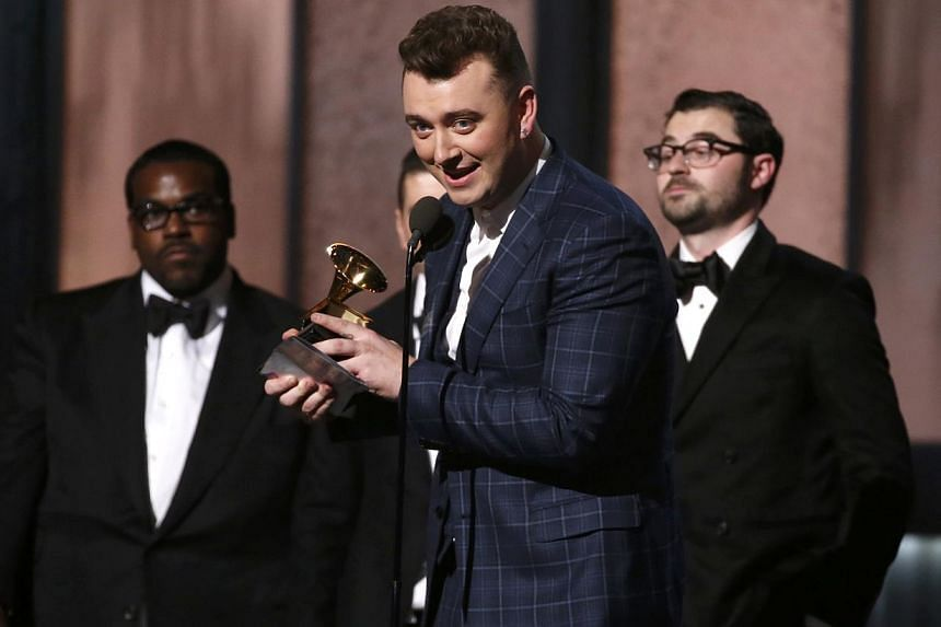 Sam Smith accepts the award for record of the year for 'Stay With Me (Darkchild Version)' at the 57th annual Grammy Awards in Los Angeles, California on Feb 8, 2015. The British soul singer was the big winner on Sunday, taking both Record and Song Of