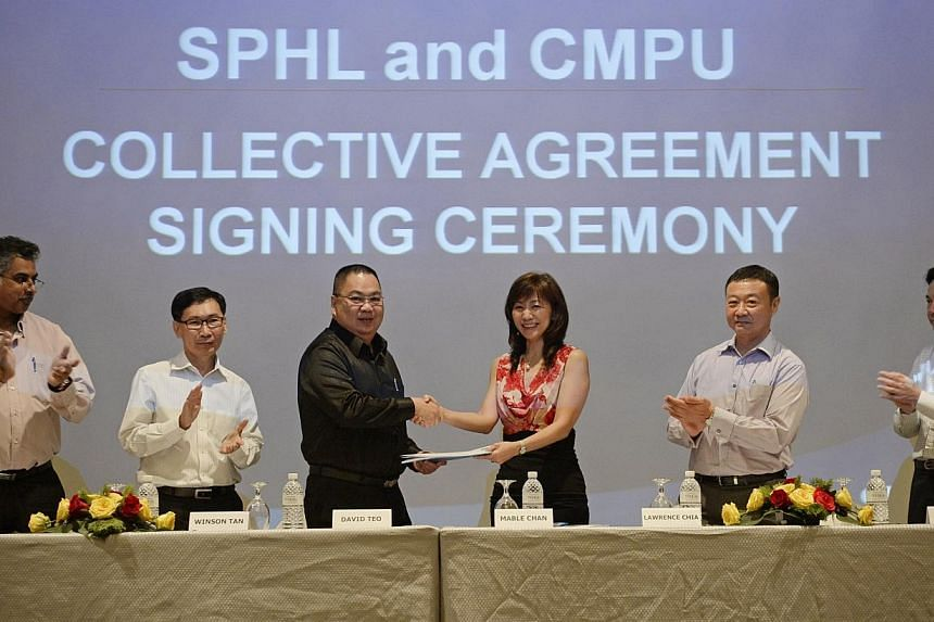 (From left) Creative Media and Publishing Union's branch treasurer Latiff Ghani, branch secretary Winson Tan, and president David Teo pictured with Singapore Press Holdings' (SPH) executive vice-president of human resources, administration and Times