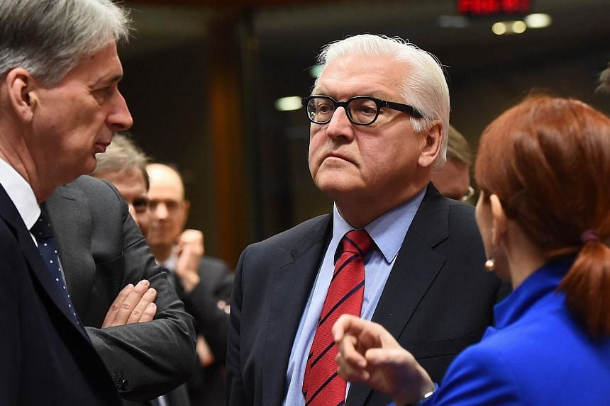 Germany's Foreign Minister Frank-Walter Steinmeier (centre) speaks with his British counterpart Philip Hammond (left) and Estonian counterpart Keit Pentus-Rosimannus during a EU foreign affairs council at the European Council, in Brussels, on Feb 9,