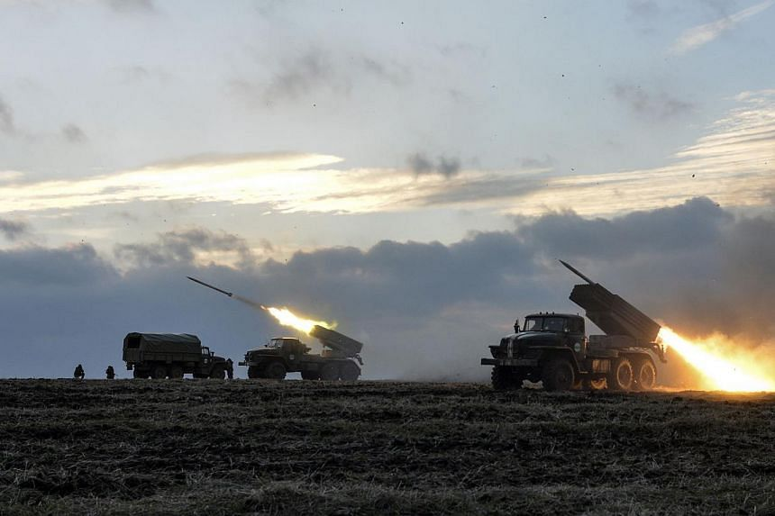 Ukrainian servicemen launch Grad rockets towards pro-Russian separatist forces outside Debaltseve, eastern Ukraine on Feb 8, 2015.At least 1,500 Russian troops and convoys of military hardware entered Ukraine over the weekend, the Ukrainian mil