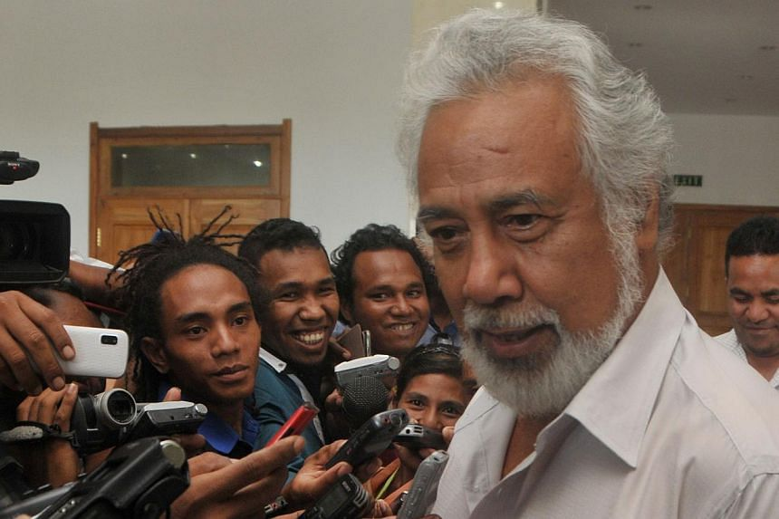 East Timor's then Prime Minister Xanana Gusmao (right) speaks to journalists in Dili after a meeting with President Taur Matan Ruak on Feb 2, 2015.The President accepted the resignation of independence hero Gusmao as prime minister on Monday, F
