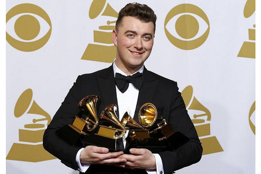 Sam Smith posing with his awards for Best New Artist, Best Pop/Vocal Album for In The Lonely Hour and Song of the Year and Record of the Year for Stay With Me in the press room at the 57th annual Grammy Awards in Los Angeles, California on Feb 8, 201