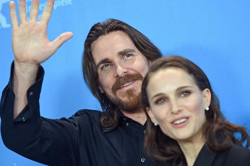 US actress Natalie Portman and British actor Christian Bale pose during a photocall for Knight of Cups at the 65th annual Berlin Film Festival on Sunday. The movie is presented in the Official Competition of the Berlinale. -- PHOTOS: EPA