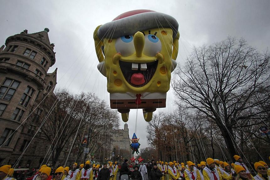 A SpongeBob Squarepants balloon floats down Central Park West during the 88th Macy's Thanksgiving Day Parade in New York Nov 27 last year. -- PHOTO: REUTERS