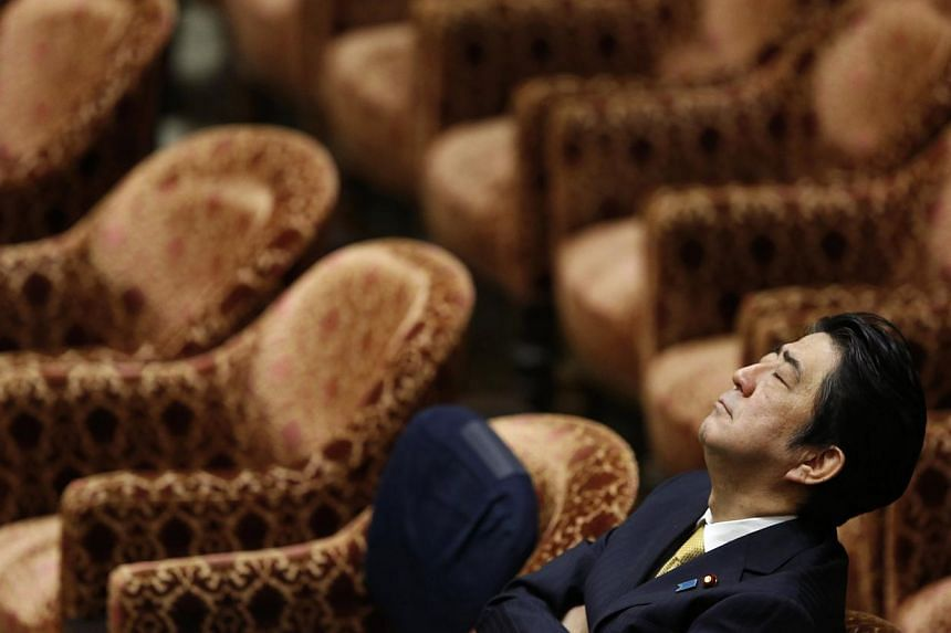 Japan's Prime Minister Shinzo Abe closes his eyes during a Lower House committee session at the parliament in Tokyo on February 4, 2015. The world might prefer the Japanese government to take a stronger stand against terrorism, but Prime Minister Shi