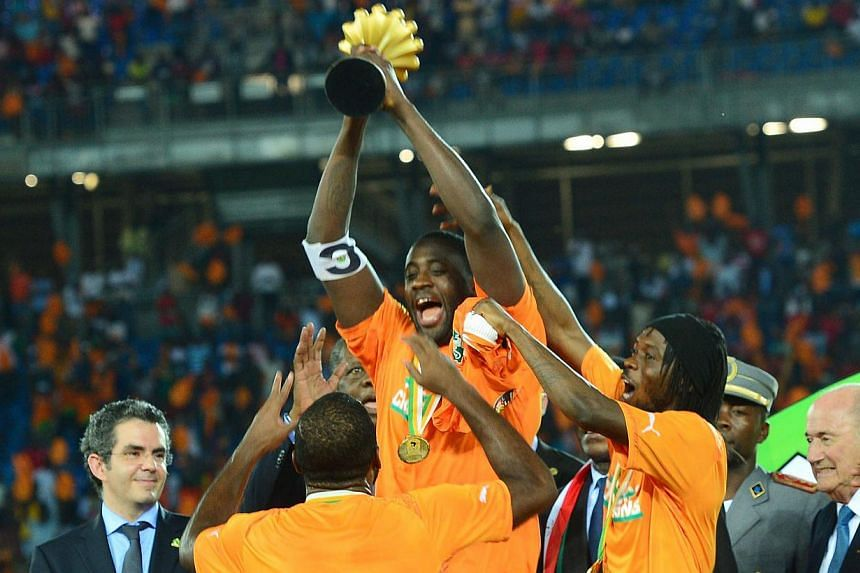 Yaya Toure lifting the trophy at the Bata Stadium in Bata, Equatorial Guinea, on Feb 8, 2015. -- PHOTO: EPA