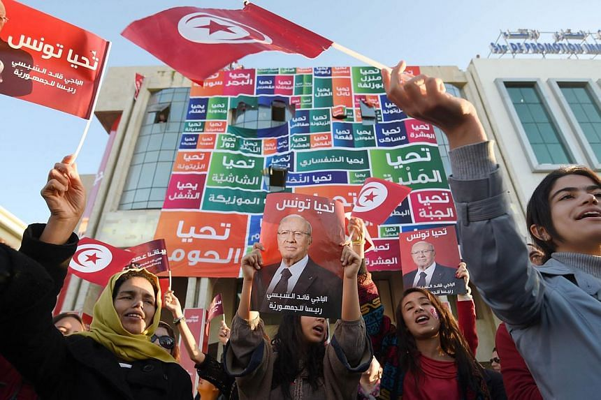 Supporters of Tunisia's newly-elected President Beji Caid Essebsi on Dec 22. The country was where the Arab Spring movement began. However, naive Western responses to the movement, along with the ill-considered 2003 American intervention in Iraq, bro