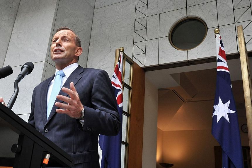 Tony Abbott, Australia's prime minister, speaks during a news conference at Parliament House in Canberra, Australia, on Monday, Feb 9, 2015. Abbott on Thursday urged tighter screening of migrants after police thwarted an alleged terror attack, while