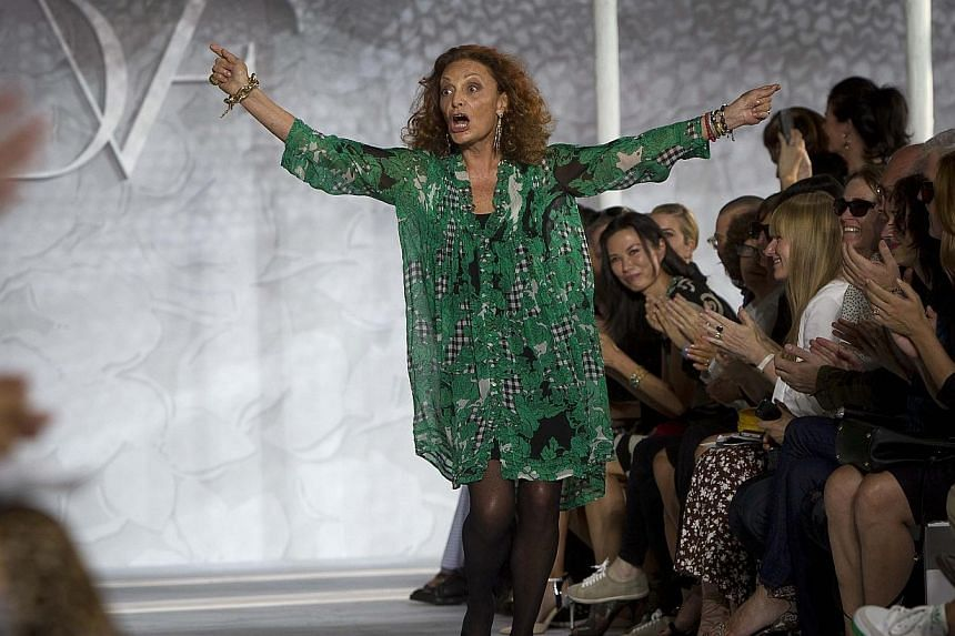Designer Diane von Furstenberg acknowledges the crowd following her Spring/Summer 2015 collection show during New York Fashion Week in the Manhattan borough of New York in this Sept 7, 2014 file photo. -- PHOTO: REUTERS