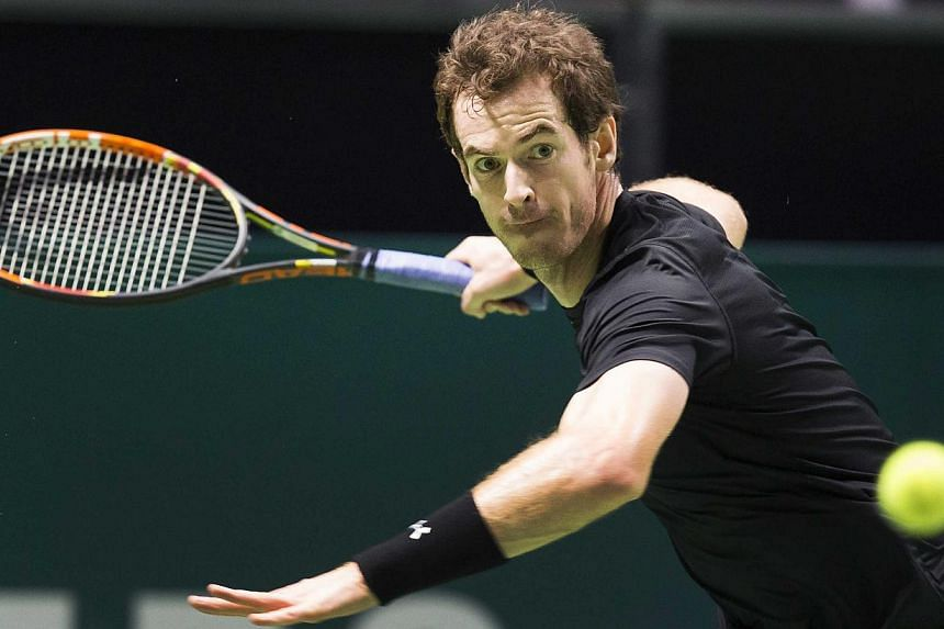 British Andy Murray returns the ball to French Nicolas Mahut during their first round match of the ABN AMRO World Tennis Tournament in Rotterdam, The Netherlands, on Feb 11, 2015. -- PHOTO: EPA