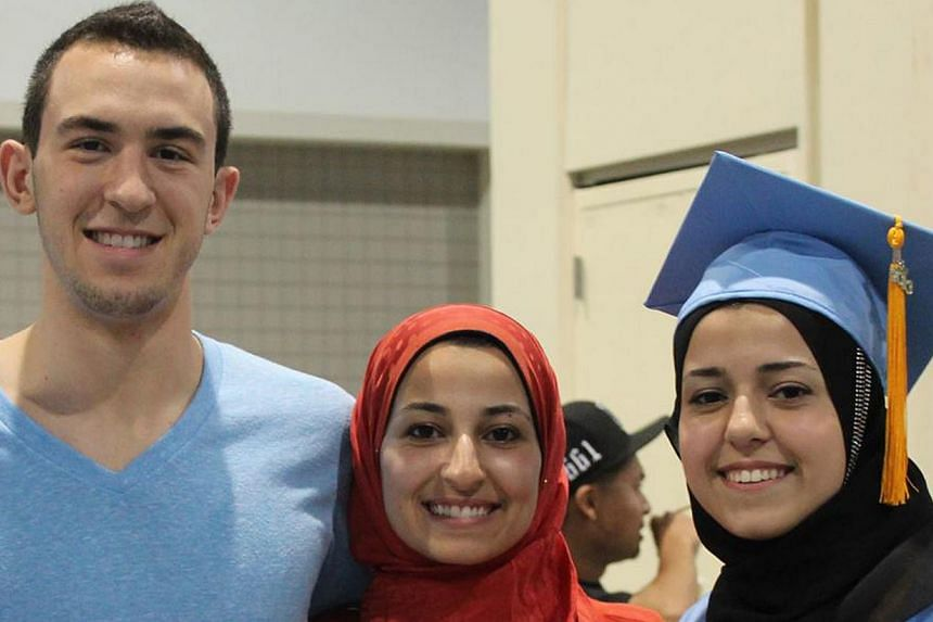 Chapel Hill victims Mr Deah Shaddy Barakat, his wife Yusor Mohammad Abu-Salha and her sister Razan Mohammad Abu-Salha. -- PHOTO: DEAH BARAKAT FROM FACEBOOK