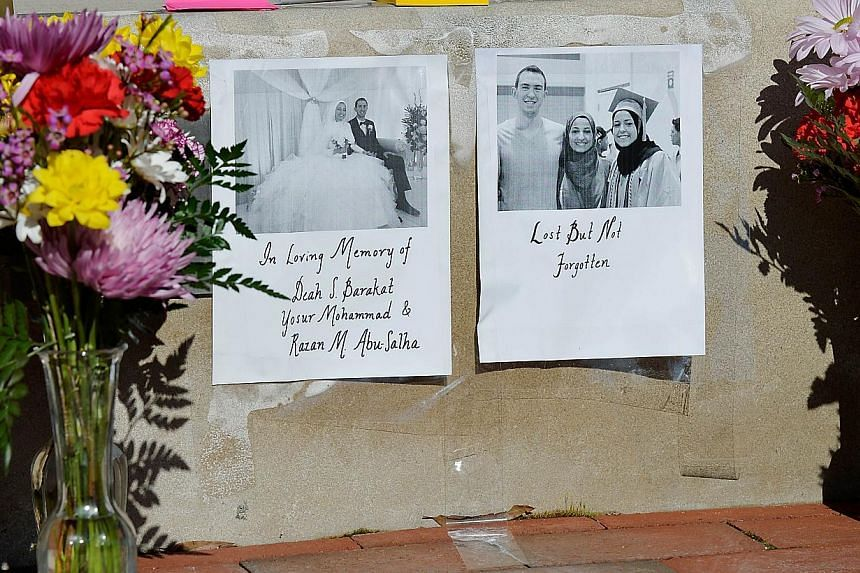 Flowers outside the University of North Carolina School of Dentistry in recognition of dentistry student Deah Barakat, 23, his new wife Yusor Mohammad Abu-Salha, 21, and her sister Razan Mohammad Abu-Salha, 19, in Chapel Hill, North Carolina on Feb 1