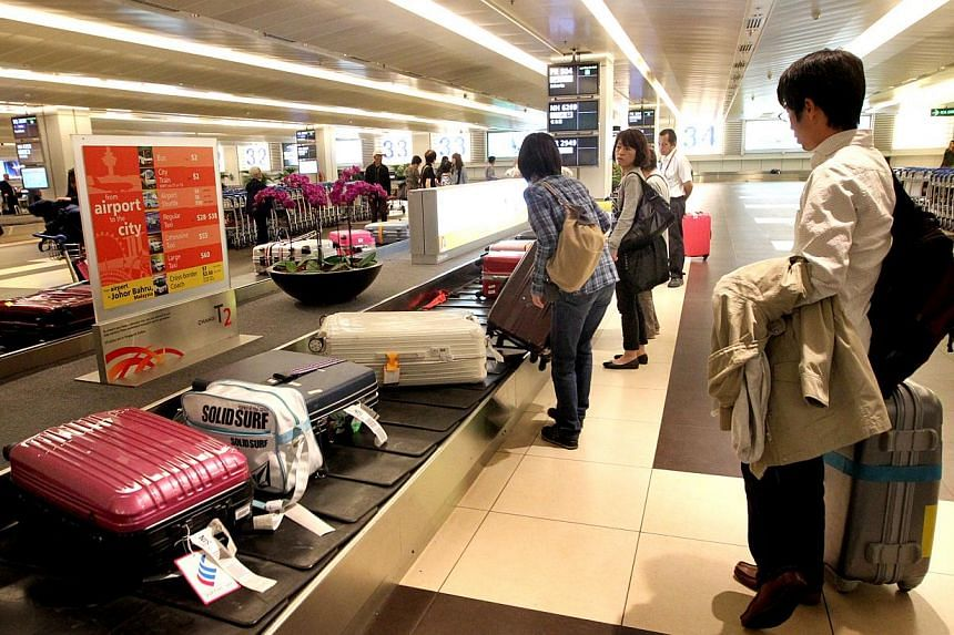 Changi Airport has set aside $17 million to find better methods of loading bags and cargo onto planes. -- PHOTO: ST FILE