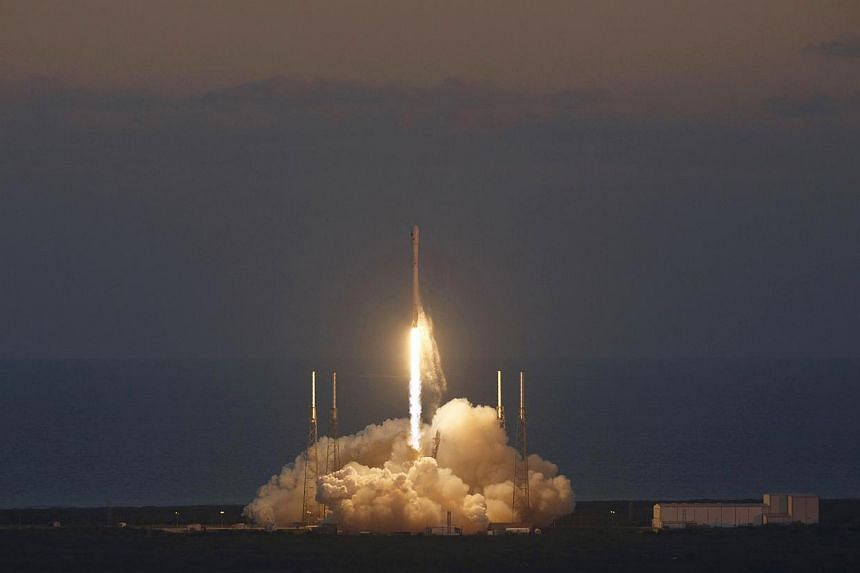 The unmanned Falcon 9 rocket, launched by SpaceX and carrying NOAA's Deep Space Climate Observatory Satellite, lifts off from launch pad 40 at the Cape Canaveral Air Force Station in Cape Canaveral, Florida on Feb 11, 2015. -- PHOTO: REUTERS