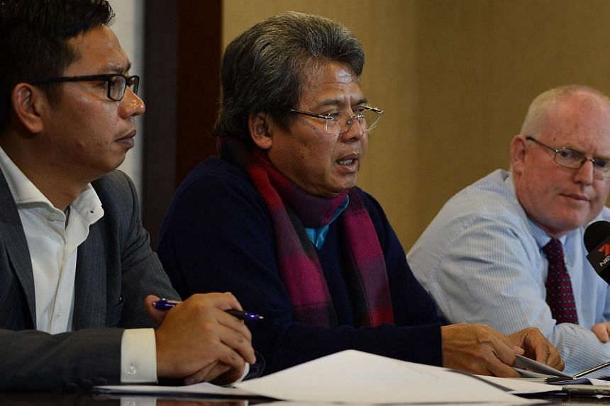 In this Feb 9, 2015 photo, Indonesian lawyers Todung Mulya Lubis (centre), Doly James (left) and Australian lawyer Julian McMahon (right) speak at a press conference in Jakarta. They are fighting to save two Australian prisoners, Andrew Chan and Myur