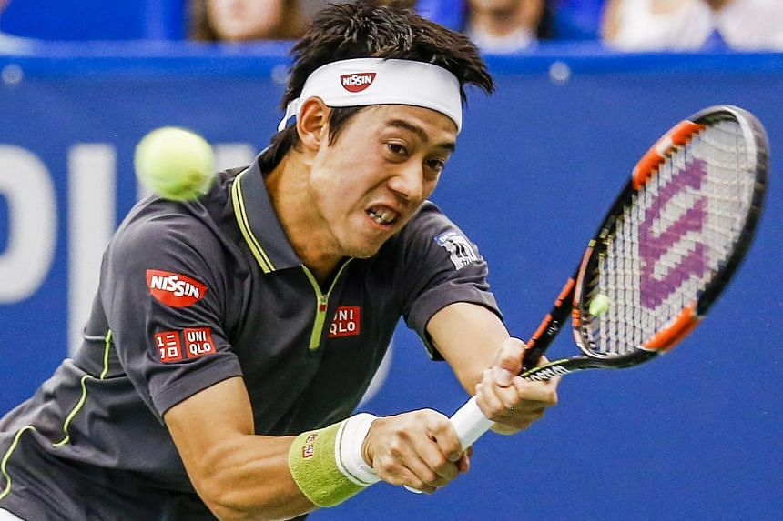 Kei Nishikori of Japan hits a return shot to Ryan Harrison of the US in their Memphis Open tennis match at the Racquet Club of Memphis in Memphis, Tennessee, USA on Feb 11,2015. Nishikori rallied to get past Harrison on Wednesday to book his qu
