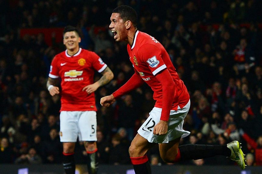 Manchester United's Chris Smalling (right) celebrating after scoring against Burnley FC at Old Trafford in Manchester, on Feb 11, 2015. -- PHOTO: EPA