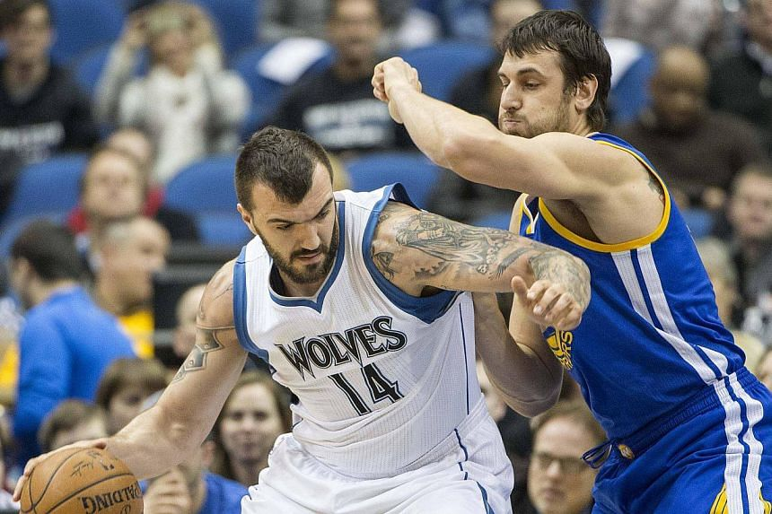 Minnesota Timberwolves centre Nikola Pekovic dribbling through Golden State Warriors centre Andrew Bogut in the first half at Target Center. -- PHOTO: REUTERS/JESSE JOHNSON/USA TODAY SPORTS