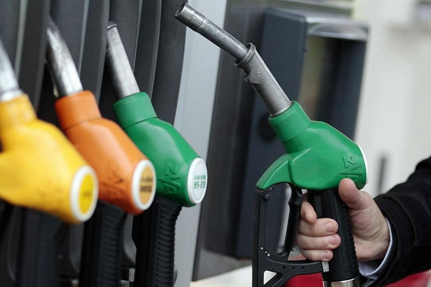Any serious effort to lower greenhouse gas emissions is certainly going to raise prices on petrol or electricity. -- PHOTO: REUTERS