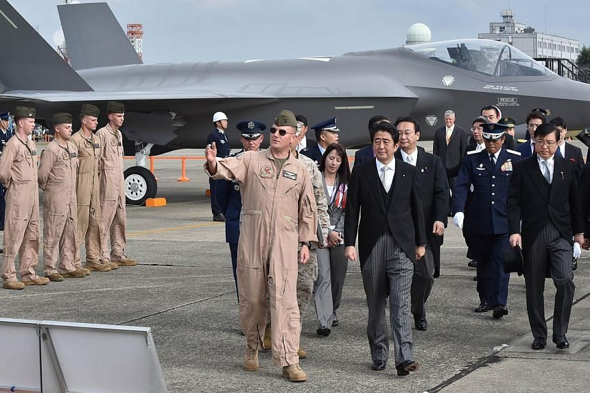 Japanese Prime Minister Shinzo Abe at a review ceremony at the Self-Defence Forces' Hyakuri air base in Ibaraki prefecture last October. The country's defence budget for this year is set to cover state-of-the-art military acquisitions, including F-35