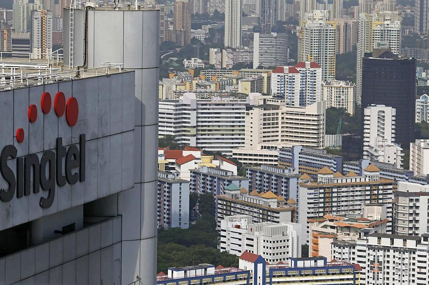 Singtel reported a $970 million third-quarter net profit, an 11 per cent rise, on strong performance at home and higher contributions from its regional associates. -- PHOTO: REUTERS