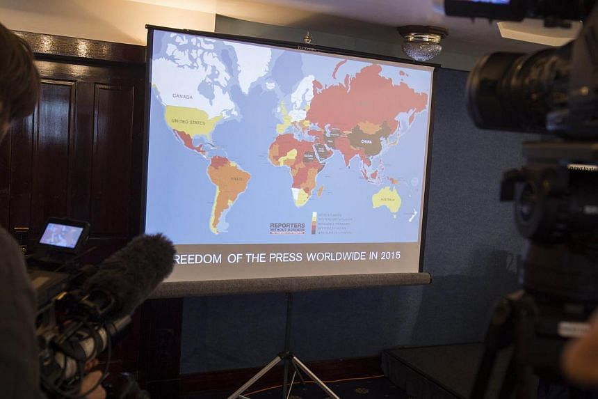 Journalists filming a map showing the World Press Freedom Index 2015 during a press conference at the National Press Club in Washington, DC, on Feb 11, 2015. -- PHOTO: AFP