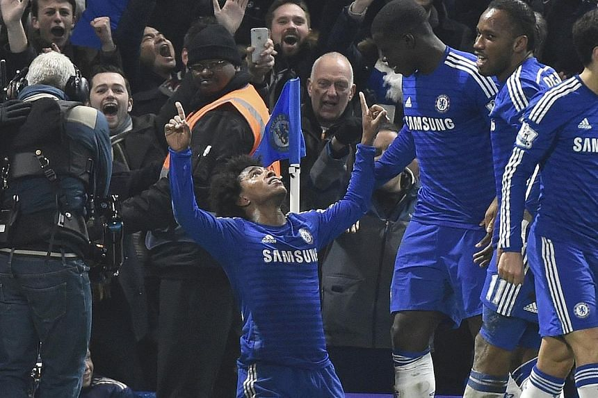 Willian (centre) of Chelsea celebrating after scoring against Everton at Stamford Bridge, London, on Feb 11, 2015. -- PHOTO: REUTERS