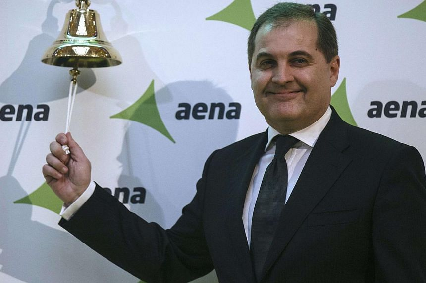 Jose Manuel Vargas Gomez, president of Spanish airports group Aena, poses ringing a bell during their stock market debut at the bourse in Madrid Feb 11, 2015. -- PHOTO: REUTERS