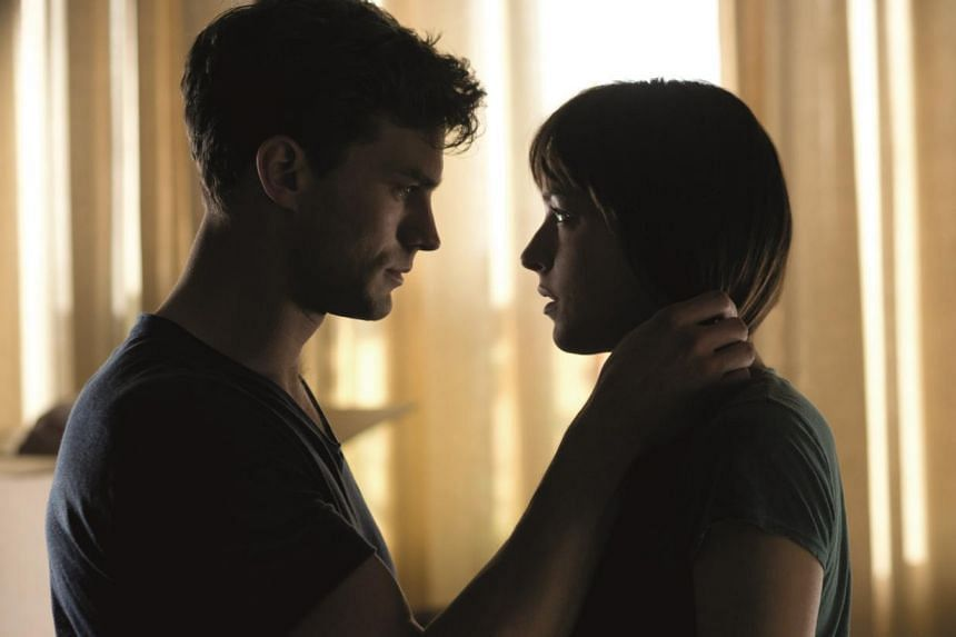 Jamie Dorman and Dakota Johnson star in Fifty Shades Of Grey. -- PHOTO: UNIVERSAL PICTURES