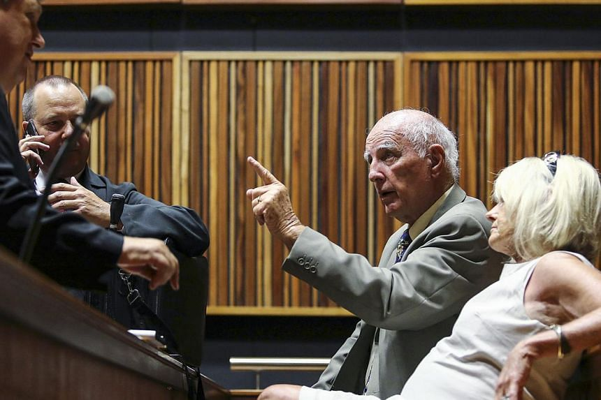 Former Grand Slam doubles champion Bob Hewitt (second right) gestures ahead of court proceedings at the South Gauteng High Court in Johannesburg, Feb 9, 2015. -- PHOTO: REUTERS