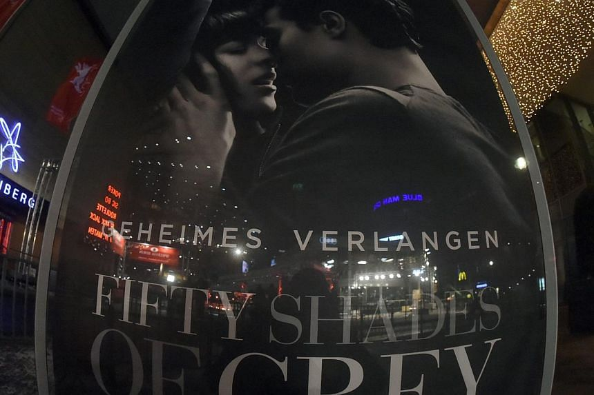 A view of a poster for the movie Fifty Shades Of Grey in Berlin, Germany, on Feb 4 2015. The long-anticipated movie version of the bestselling erotic novel, began its worldwide rollout on Wednesday, opening in theatres across France, Germany, Belgium