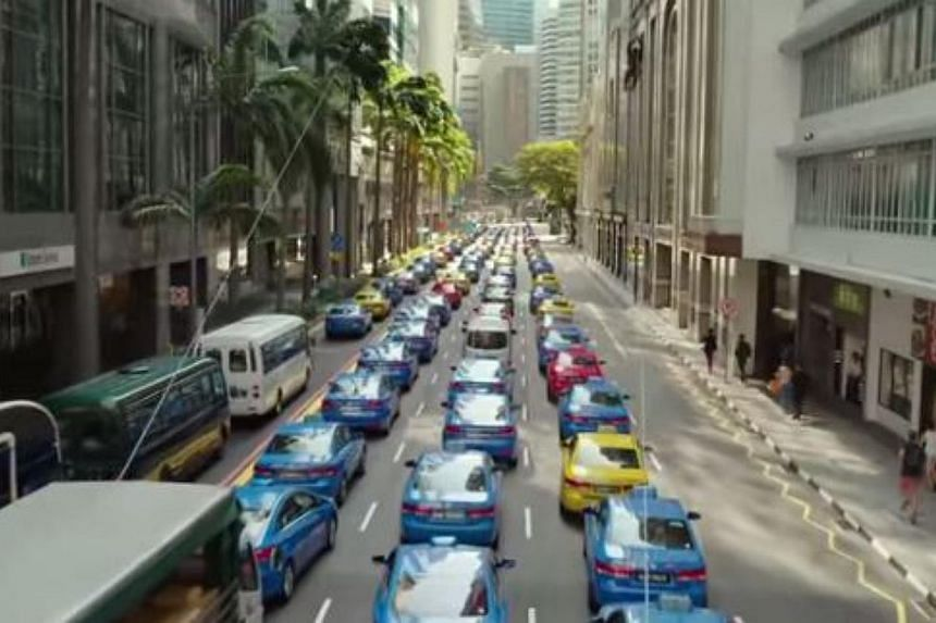 Singapore's iconic blue Comfort taxis are seen in the new trailer of upcoming Hollywood film Hitman: Agent 47. -- PHOTO: YOUTUBE