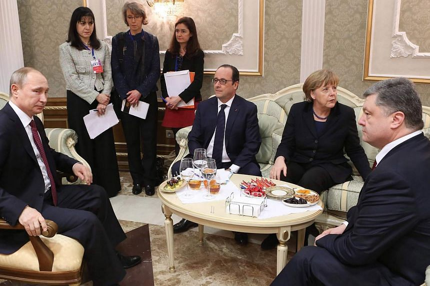 (Seated, from left) Russian President Vladimir Putin, French President Francois Hollande, German Chancellor Angela Merkel and Ukrainian President Petro Poroshenko meet at the Palace of Independence in Minsk, Belarus, on Feb 11, 2015. -- PHOTO: EPA
