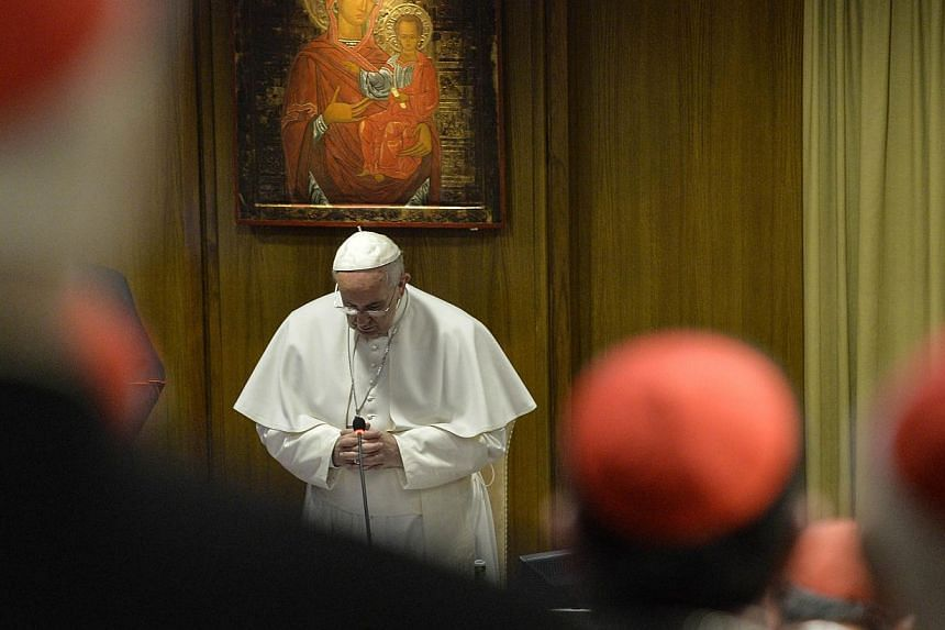 Pope Francis addresses cardinals and bishops at the opening of the Papal consistory at the Vatican on Feb 12, 2015. -- PHOTO: AFP