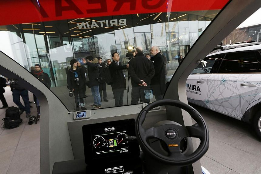 A prototype of a Lutz Pathfinder driverless vehicle is displayed to members of the media in Greenwich, east London, on Feb 11, 2015. Britain gave the green light on Wednesday for the testing of futuristic driverless cars on public roads in a mu