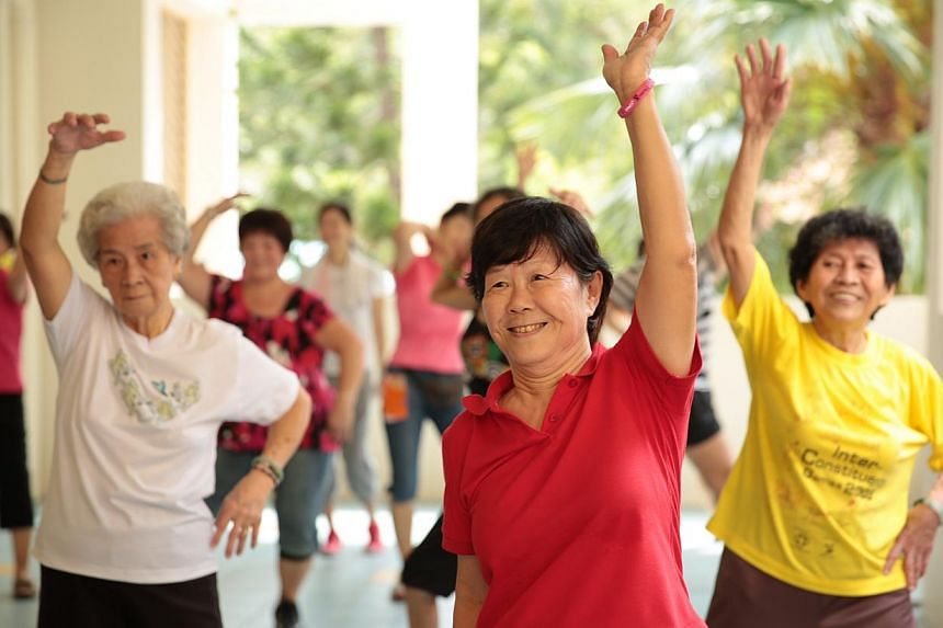 Elderly residents at Thye Hua Kwan Seniors Activity Centre in Bukit Merah practise zumba moves during a session of the Get Movin' for Charity zumba programme. While the Housing Board completed the construction of 11 senior activity centres at studio