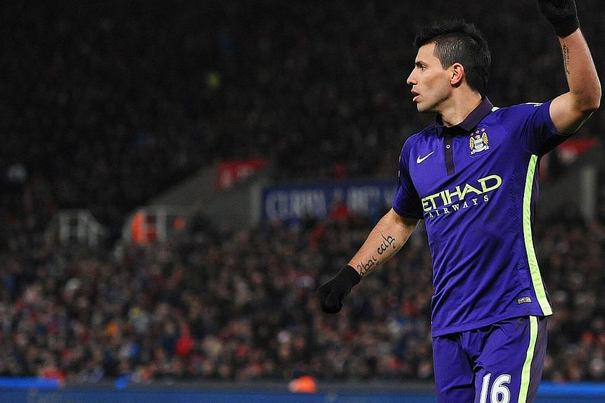 Manchester City's Sergio Aguero celebrating after scoring from the penalty spot against Stoke City at the Britannia Stadium in Stoke, on Feb 11, 2015. -- PHOTO: EPA