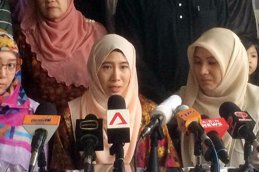 "Nurul Nuha Anwar (centre), Anwar Ibrahim's daughter, speaking at a press conference at Anwar's house in Kuala Lumpur on Feb 11, 2015. She was unveiled yesterday as the face of the ""March to Freedom"" campaign, aimed at ratcheting up pressure at home a"