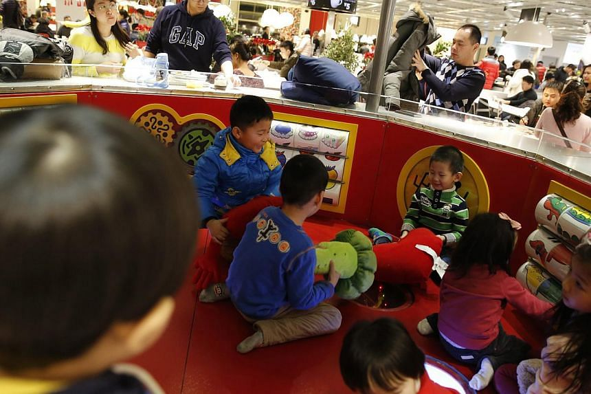 Children playing at a furniture shop in Beijing on Feb 3, 2015. -- PHOTO: EPA
