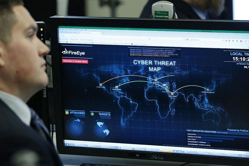 A Department of Homeland Security worker listening to US President Barack Obama speak at the National Cybersecurity and Communications Integration Centre in Arlington, Virginia, on Jan 13, 2015 -- PHOTO: REUTERS