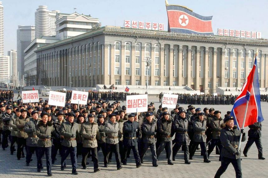 A picture released by the North Korean Central News Agency on Feb 9, 2015, shows North Korean men marching at Kim Il-Sung Square in Pyongyang, on Feb 8, 2015, to celebrate the 67th anniversary of the North's regular armed forces. -- PHOTO: EPA