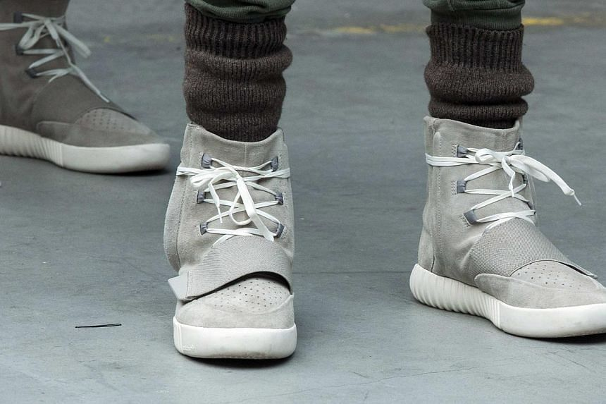 A model wearing a pair of Adidas Yeezy 750 Boost shoes designed by Kanye West as part of his Fall/Winter 2015 partnership line with Adidas at New York Fashion Week on Feb 12, 2015. -- PHOTO: REUTERS