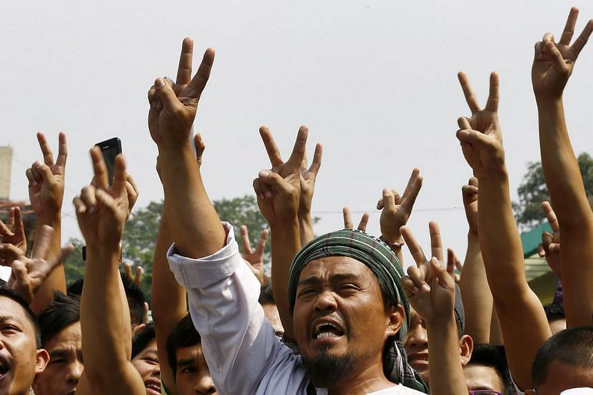 Filipino Muslims at a peace rally in Manila, Philippines on Feb 6, 2015. The group called for peace in Mindanao following a deadly clash between police and Muslim rebels in the southern Philippines. -- PHOTO: EPA