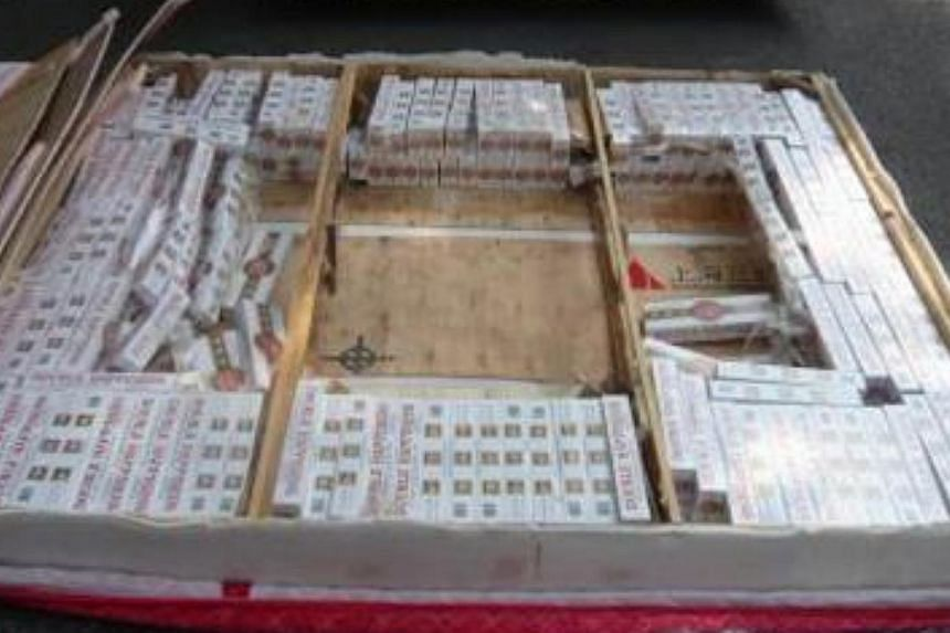 A stash of duty-unpaid cigarettes worth an estimated $104,000 was uncovered in a routine check on a Singapore-registered lorry at Keppel Distripark.--PHOTO: IMMIGRATION & CHECKPOINTS AUTHORITY